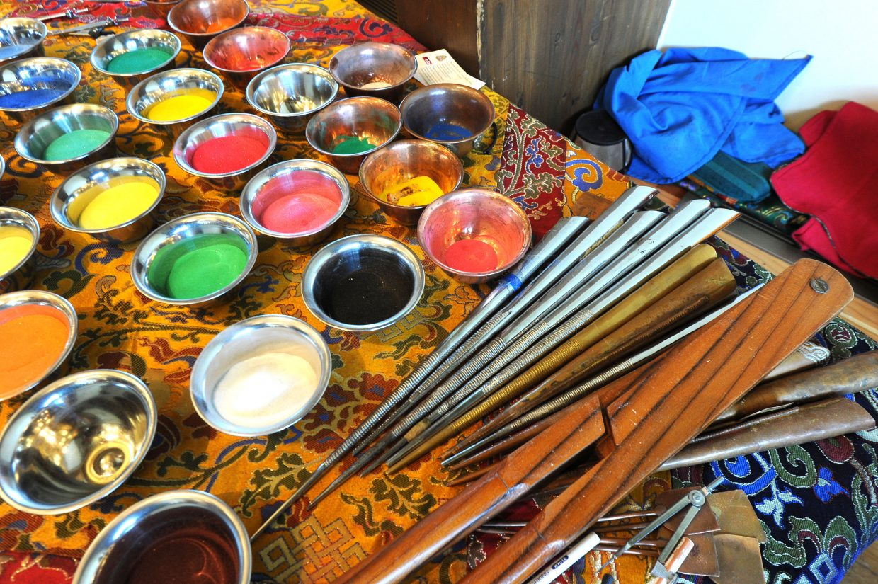 The sand and tools used to create a mandala sand painting with the Bud Werner Memorial Library's annual community sand painting. (Photo by Scott Franz).