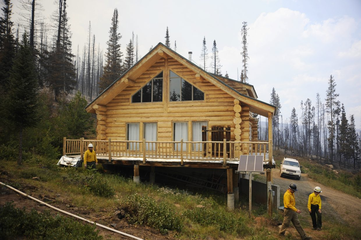 """Firefighters named this the """"miracle house,"""" because it survived when the Beaver Creek fire exploded in size Wednesday."""