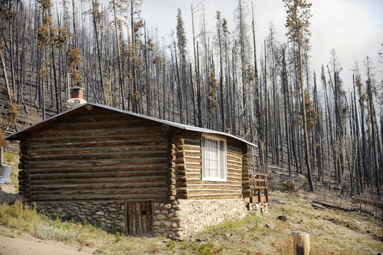 Firefighters set up sprinklers and dug fire lines to protect many cabins at the Beaver Creek fire.