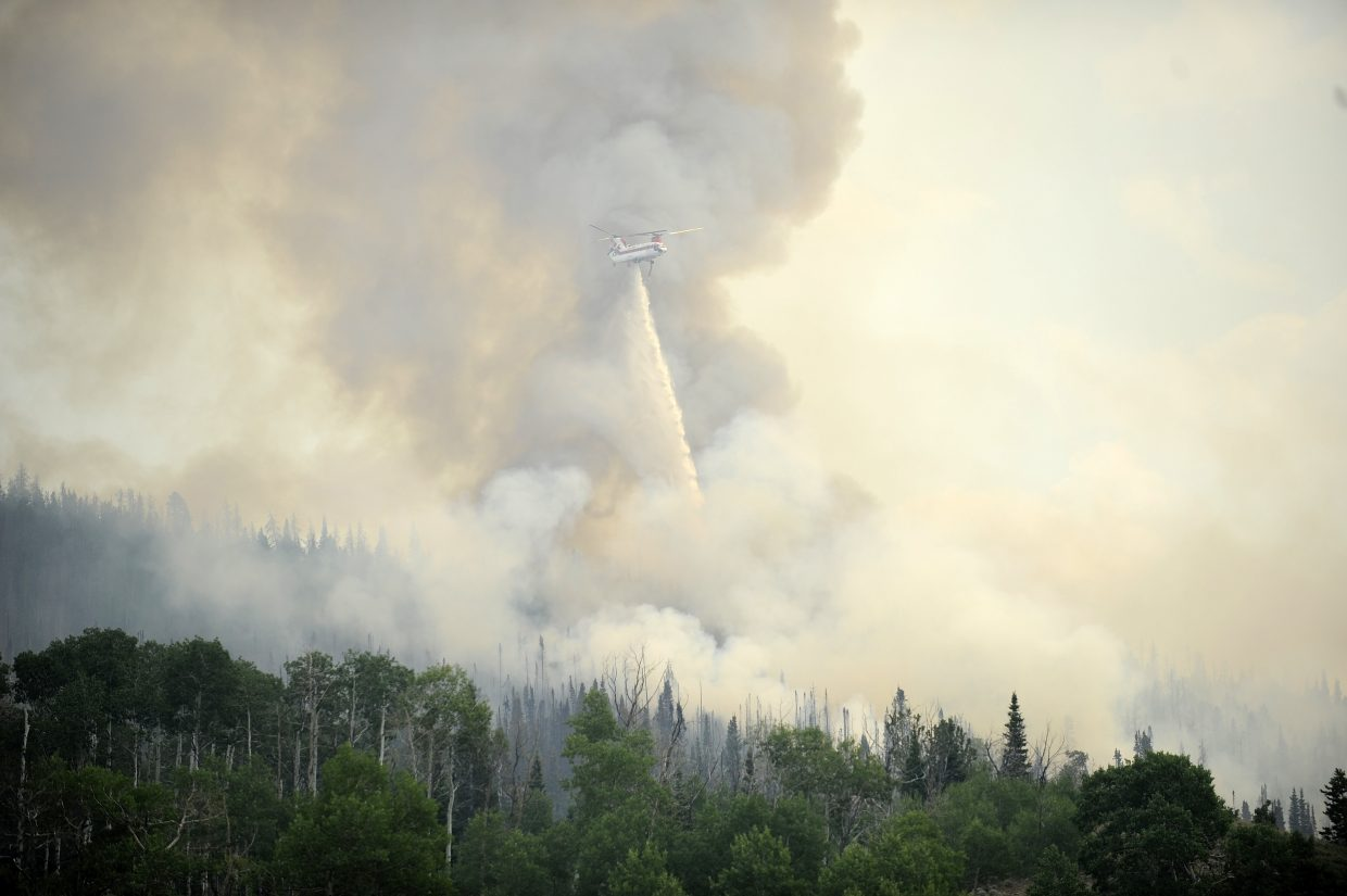 A helicopter drops water on the Beaver Creek fire Friday.
