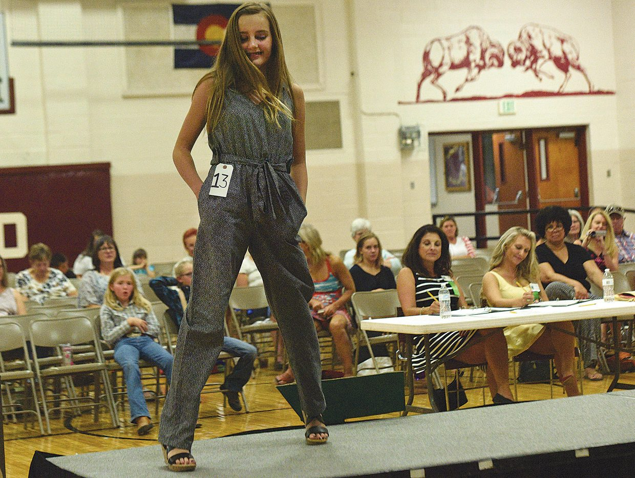 Morgan Graham models her jumpsuit during the 4-H Fashion Revue Friday at Soroco High School. The fashion show anchored the Routt County 4-H's Exhibit Day awards ceremony.