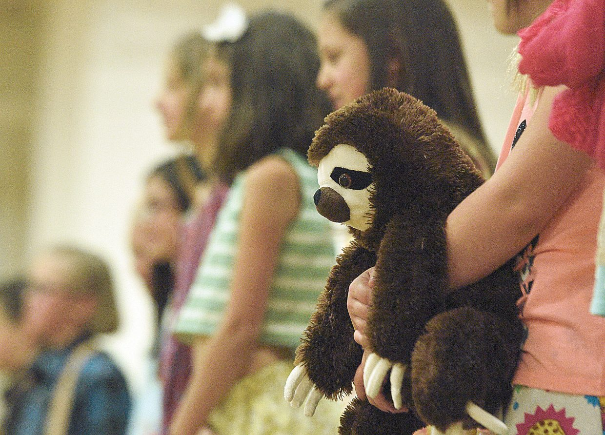 A junior holds a stuffed animal she used as a prop while standing in a line for the judges at the the 4-H fashion revue Friday evening. The event was part of the Exhibit Day and Fashion Review. The top finishers from the event will have their projects sent to the State Fair in Pueblo at the end of August.