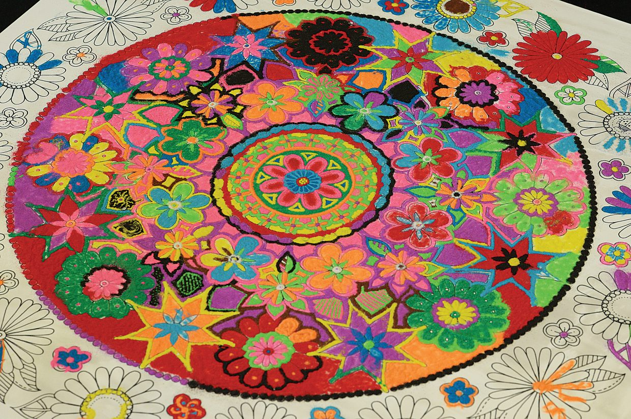 The community mandala at the Bud Werner Library takes shape Thursday afternoon.
