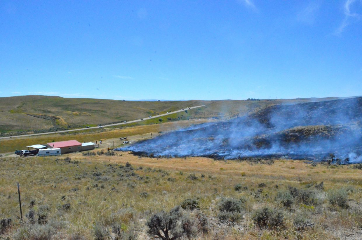 A fire near the bypass in Craig got alarmingly close to a residence Thursday afternoon. No structures were burned.