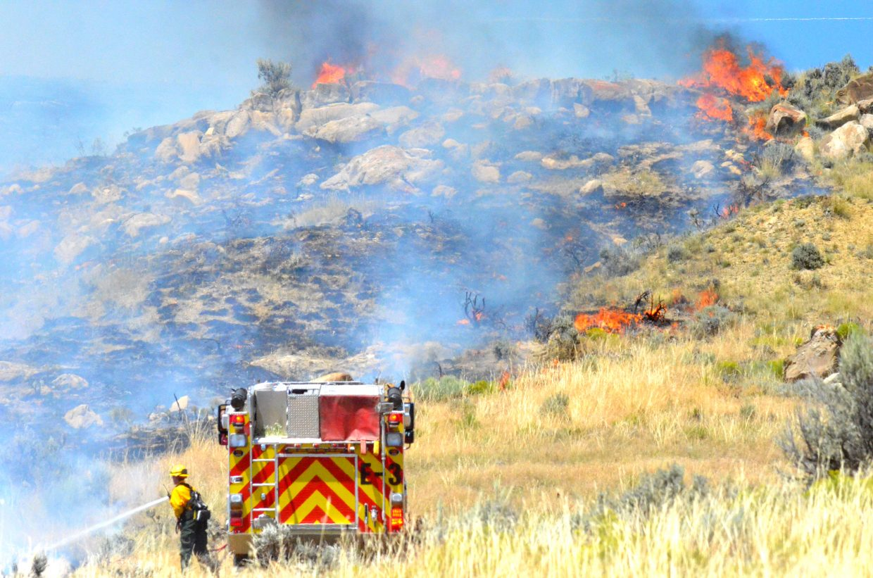Craig Fire/Rescue respond to a wildland fire on Moffat County Road 183 Thursday. It was one of four fires reported Thursday afternoon.