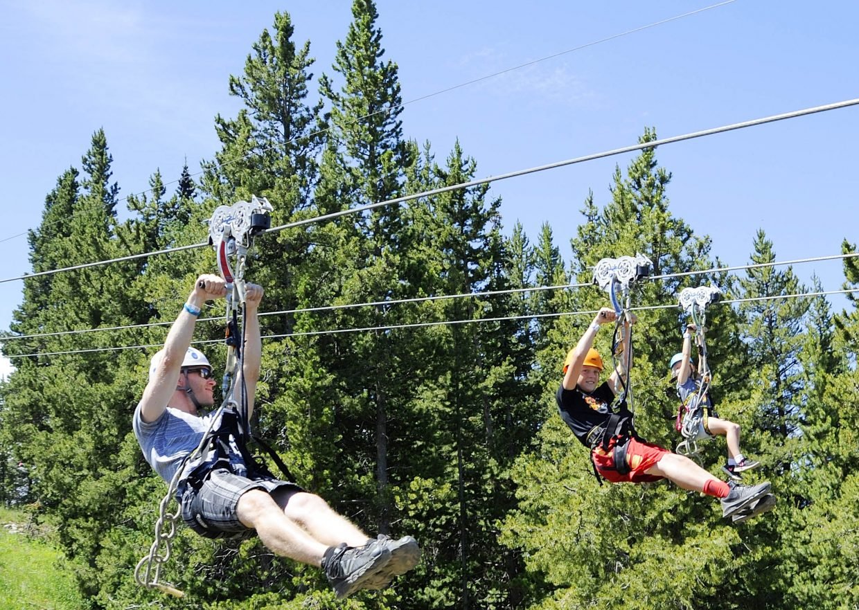 Eric Taylor and his family ride down the zip lines at Vail's Epic Discovery.