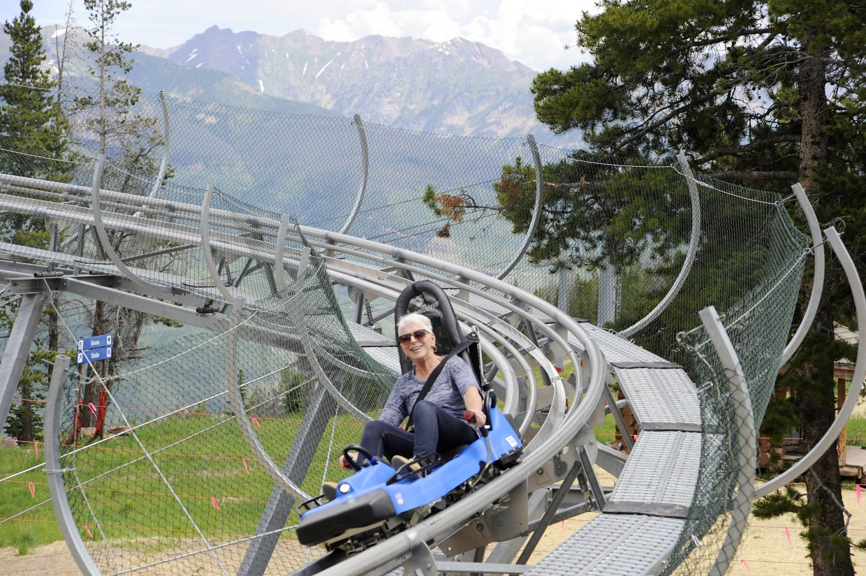 A woman rides down the mountain coaster at Vail's Epic Discovery.