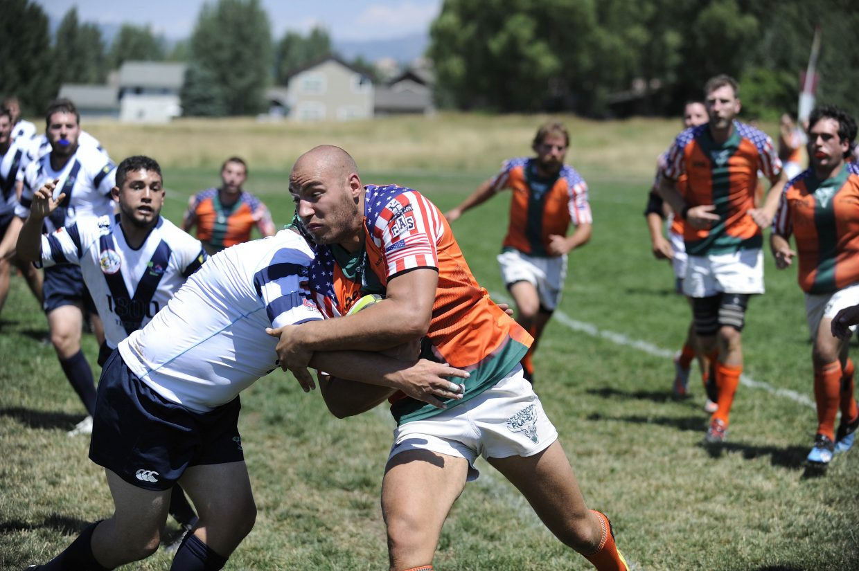 Steamboat Springs rugby player Jason Troyer brings the ball up the field during Saturday's game against Vail.