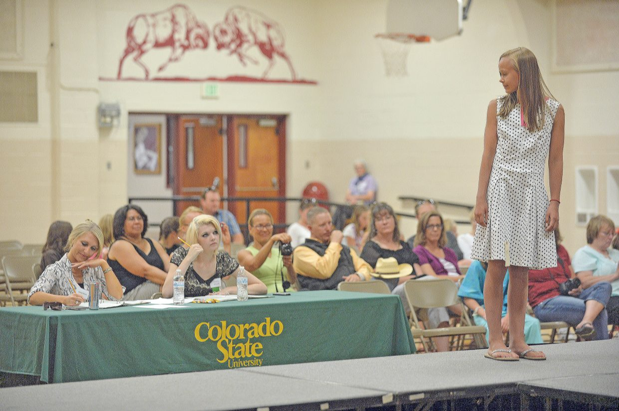 Annika Malacinski attempts to impress the judges during the Exhibit Day Fashion Show on Friday afternoon in Oak Creek. Young 4-H members got a chance to show off the clothing they made in the sewing programs this summer at the show.
