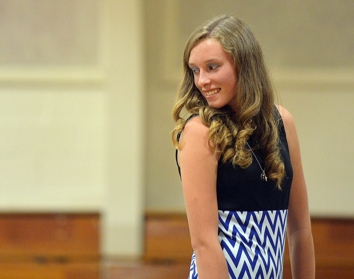 Delaney Moon shows off her shirt during the Exhibit Day Fashion Show on Friday afternoon. Young 4-H members spent who spent the summer working on their clothing in the sewing program got a chance to take center stage.