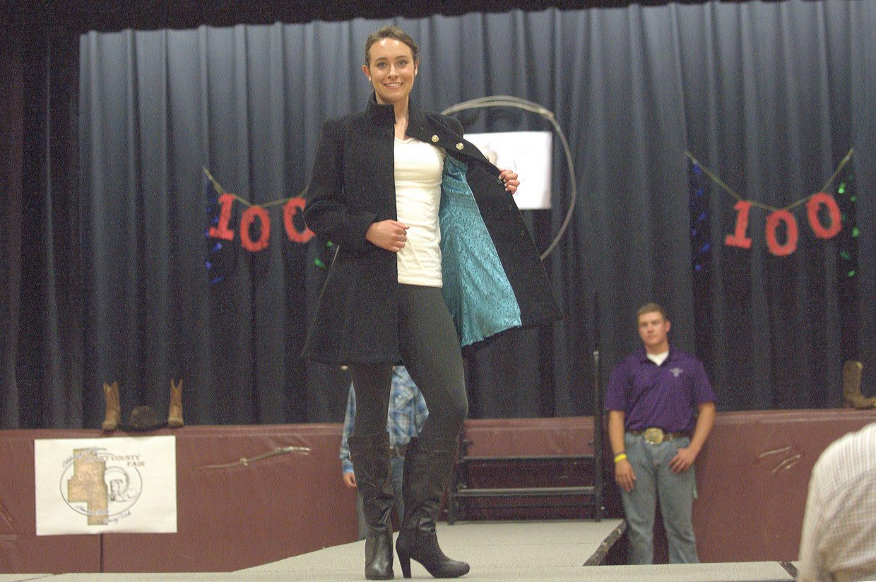 Heather Nereson shows off her wool coat during the Exhibit Day Fashion Show of Soroco High School on Friday evening. Nereson's fashions earned her a first-place and Grand Champion ribbons.