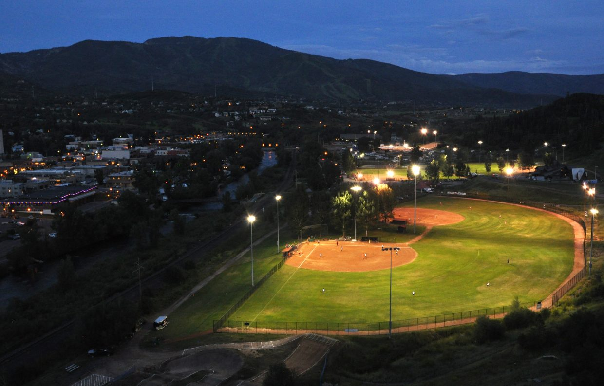 Softball players play under the lights at the Howelsen Hill ballfields. A survey of community members found most feel the park is well maintained but its facilities and infrastructure are out of date.