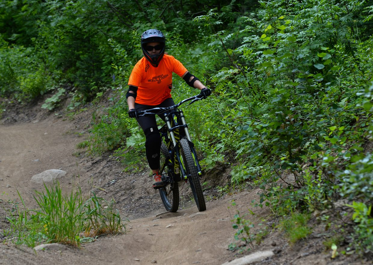 Nicole Miller heads out on her own to ride Tenderfoot in the Steamboat Bike Park.