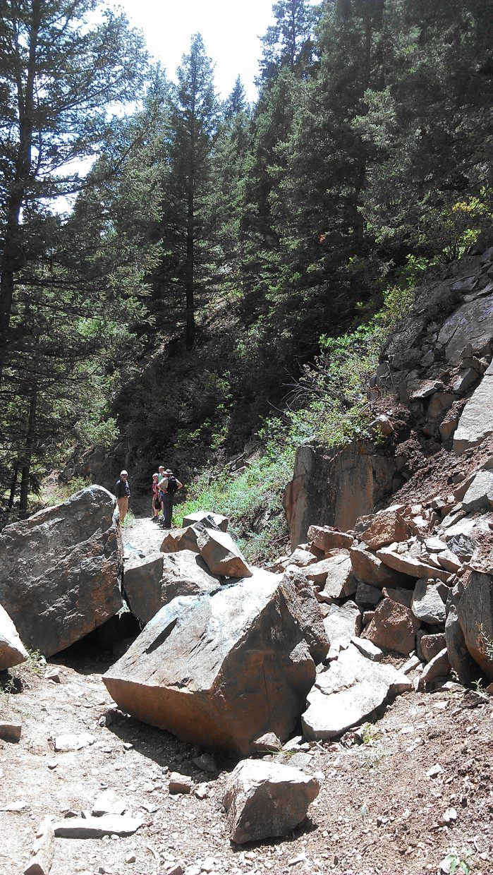 Large boulders partially block the Mad Creek Trail following a rock slide. The U.S. Forest Service is telling horseback riders to avoid the blocked trail until the boulders can be removed.