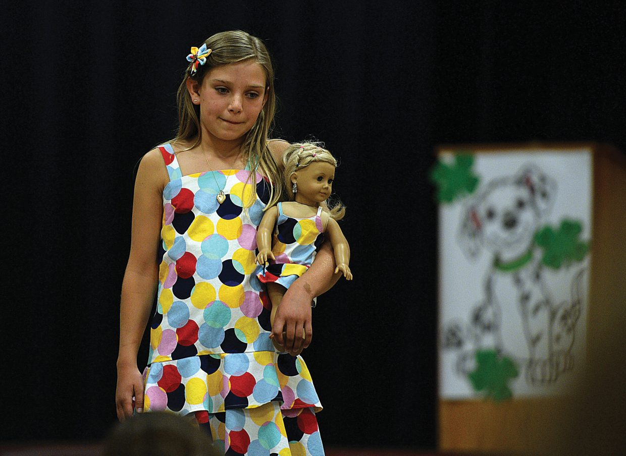 Tiinsley Wilkinson shows off the dress she made at last week's 4-H Exhibit Day and Fashion Revue at Soroco High School. The event was followed by an awards ceremony where local 4-H members where honored for their projects.