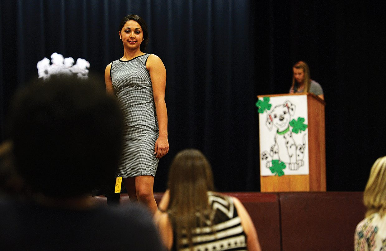 Laura Johnson shows off the dress she made during the 4-H Fashion Show on Friday evening at Soroco High School.