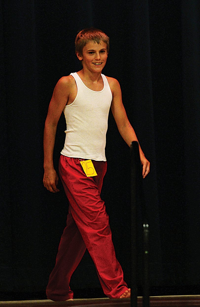 Anthony Mathey models a pair of pajama bottoms he made during the Routt County 4-H Fashion Show on Friday evening at Soroco High School.