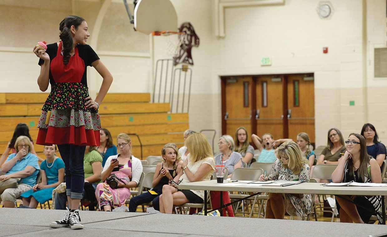Rachelle Koly models an apron she made at the Routt County 4-H Fashion show Friday evening at the Soroco High School. The show was part of the 4-H Awards Night.