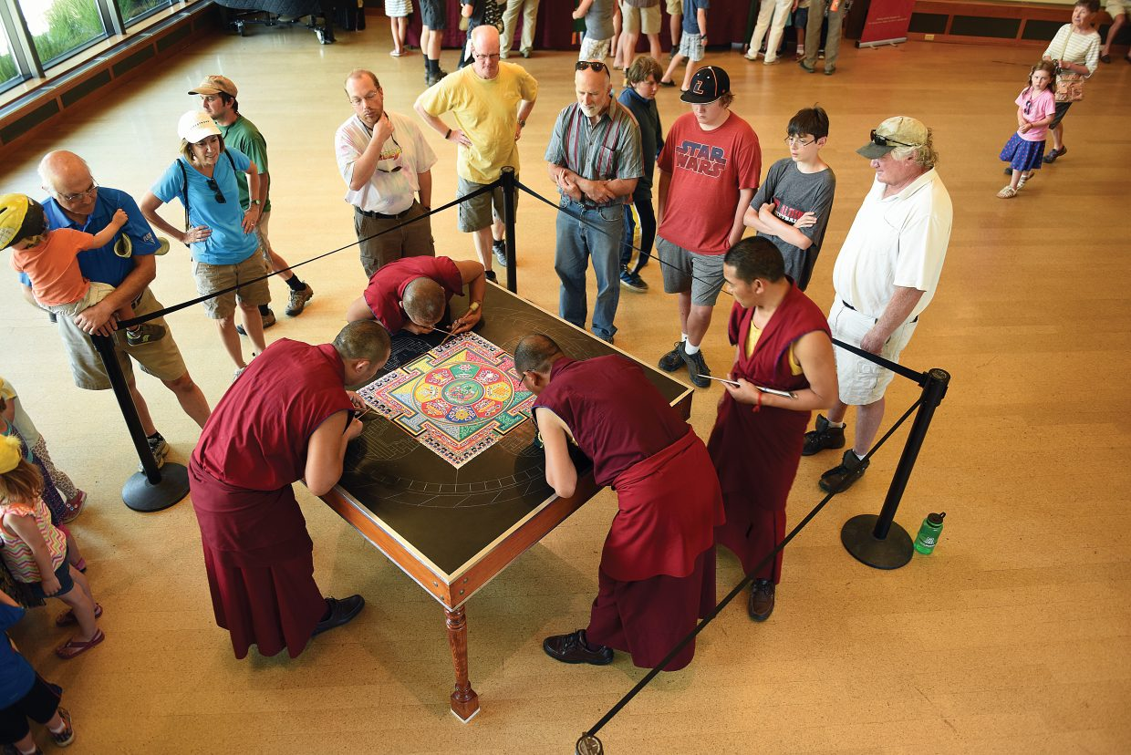 People lined up inside the Bud Werner Memorial Library to watch the monks from the Drepung Loseling monastery.
