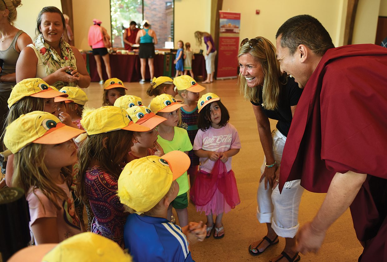 Khenul Rinpoche visits with preschoolers from Holy Name Church Friday morning at the Bud Werner Memorial Library.
