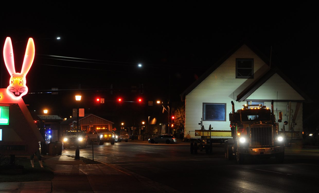 The Workman house is towed past the Rabbit Ears Motel in downtown Steamboat Springs on Thursday. Crews could go no faster than five miles an hour on the highway with the house in tow.