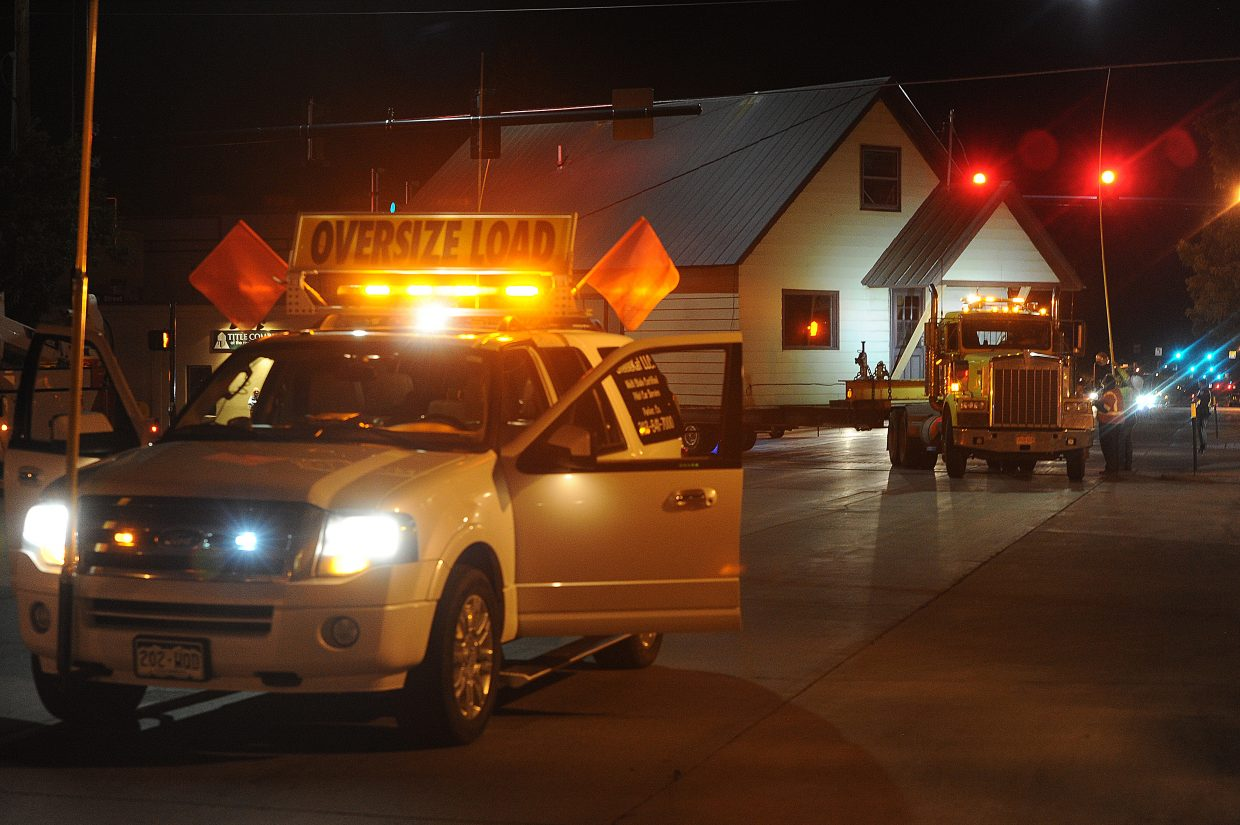 Crews move the Workman house through downtown Steamboat Springs late Thursday night. Several power lines had to be raised along the way during the eight-hour trip to the home's new spot near Oak Creek.