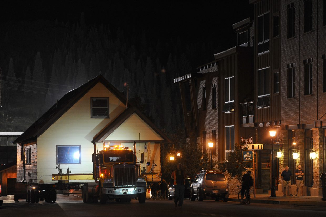 The Workman house begins its journey from Yampa Street in downtown Steamboat Springs to a new home near Oak Creek. The house was removed from downtown to make way for a public park.