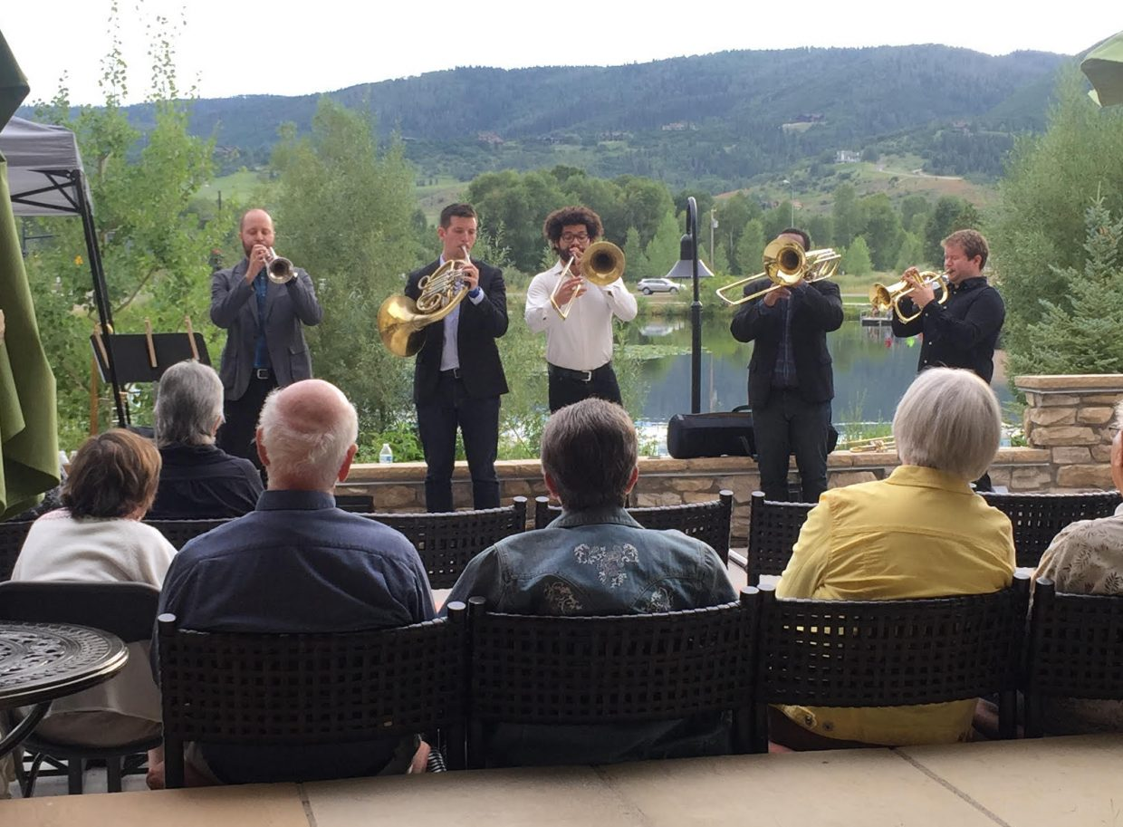 C Street Brass plays to a crowd at Casey's Pond last week.
