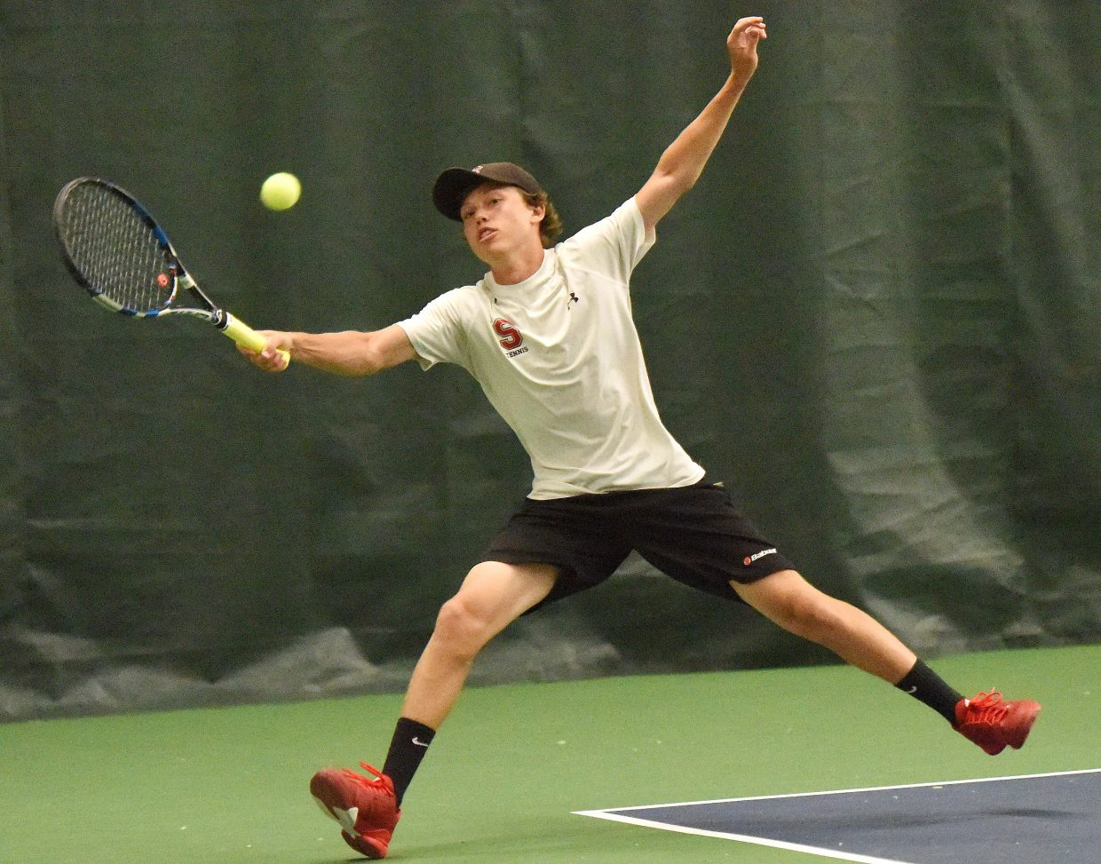 Charlie Smith reaches for a ball Sunday during the Steamboat Tennis Association tournament in Steamboat Springs.