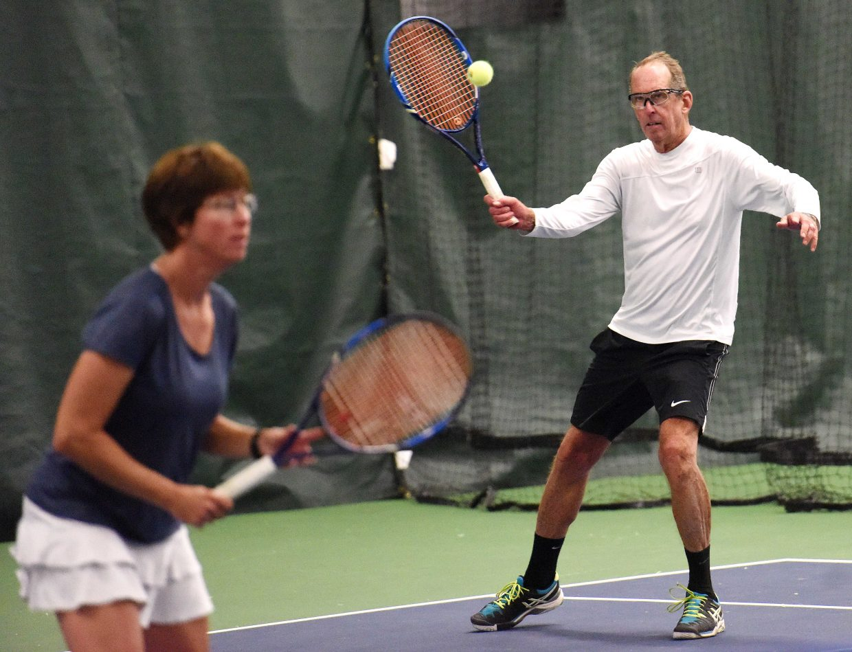 Jim Swiggart swings for a ball Sunday while playing with wife Stacy Swiggart at the Steamboat Tennis Association tournament.