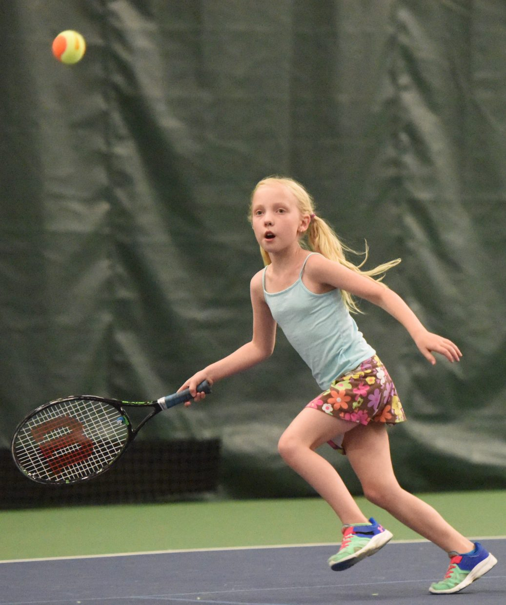 Charlotte Tegtmeyer, 9, chases down a ball Sunday at the Steamboat Tennis Association tournament.