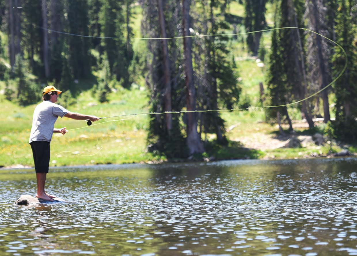 Dave Haradin casts his line into Jonah Lake on Buffalo Pass on Saturday afternoon. Haradin traveled to Buff Pass for a day of fishing and hiking with his son, Taj, and wife, Leslie Haradin.