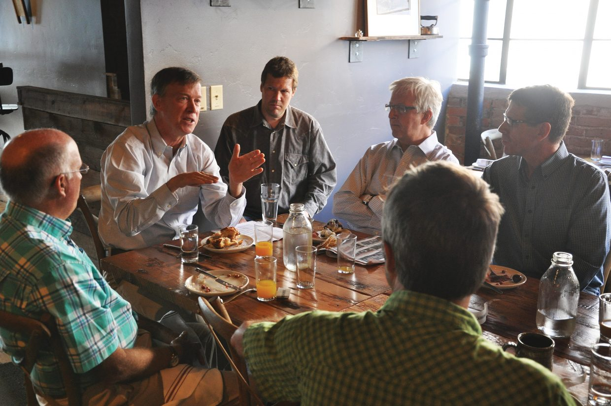 Colorado Governor John Hickenlooper speaks to local business leaders Friday morning during a breakfast at the Laundry in downtown Steamboat Springs.