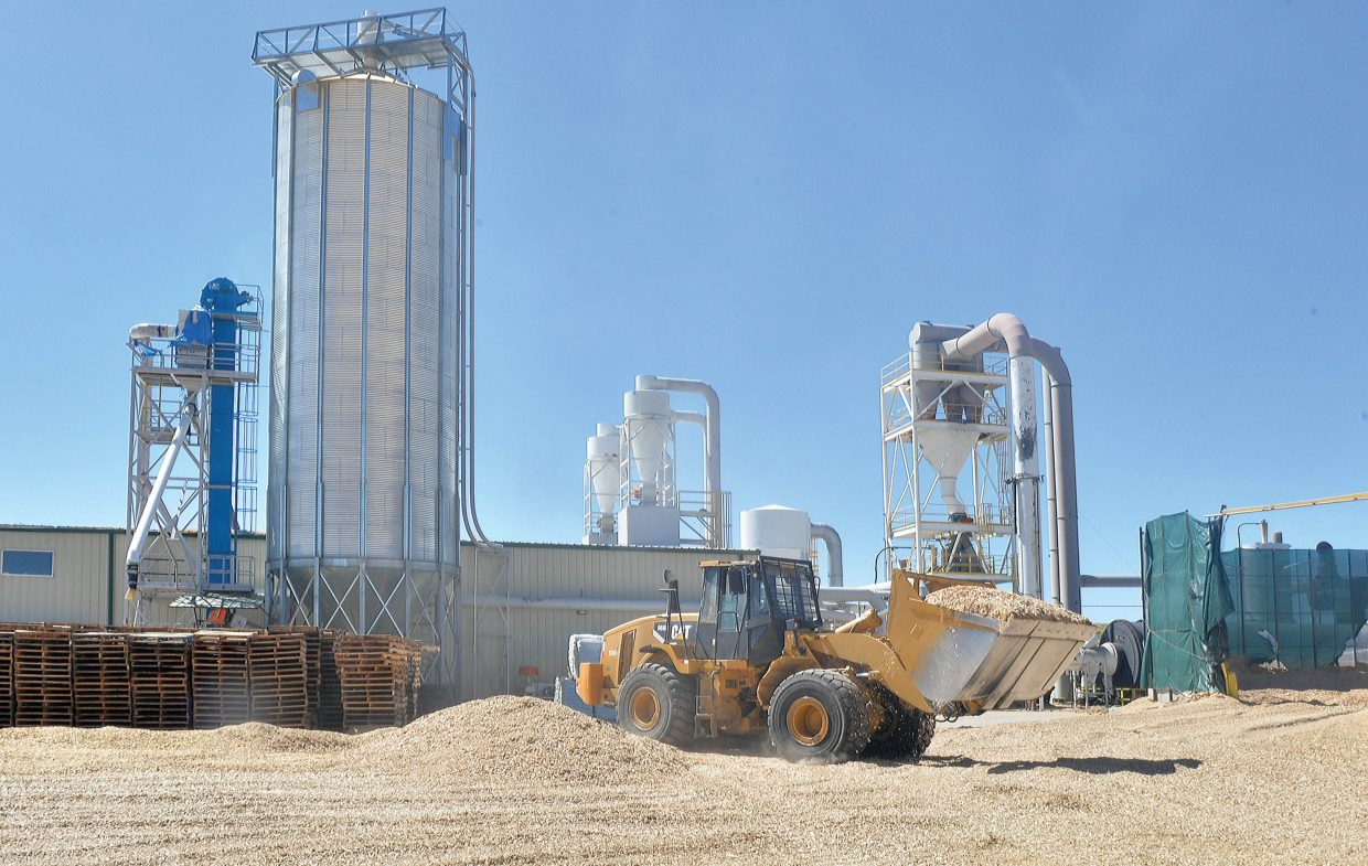 A front-end loader mixes wood chips at the processing plant in Walden. The chips then will be moved to the chip pit were the material will begin the process of being made into wood-pellets or a material used to adsorb oil, gas and solvent spills in the oil and gas industry.