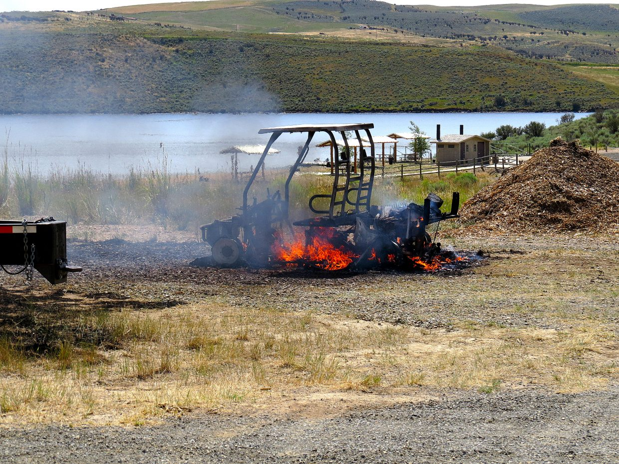 A Utility Task Vehicle burst into flames at Elkhead reservoir on Sunday.