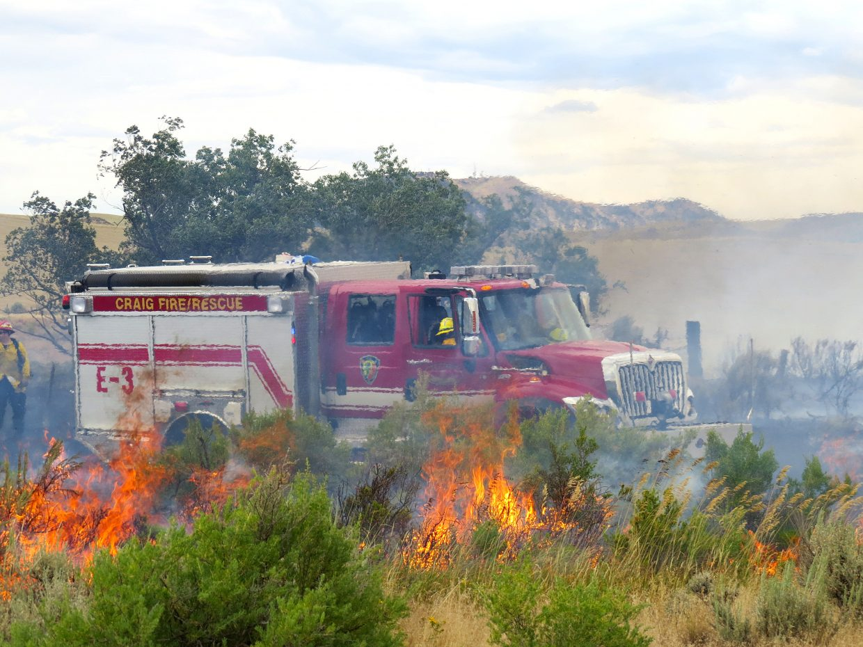 Grass and sagebrush burns in a wildfire Craig Fire/Rescue responded to Sunday.
