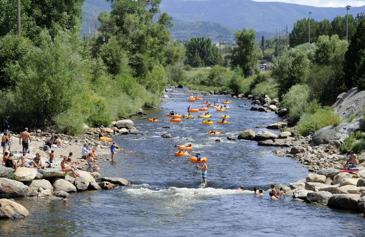 Tubers and swimmers enjoy the Yampa River on Saturday afternoon.