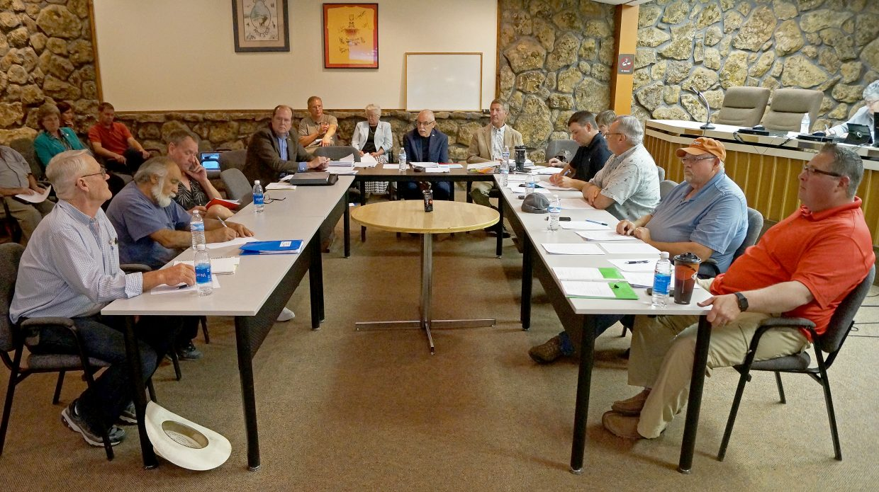 The initial Moffat County Local Marketing District board, made up of members of Moffat County Board of Commissioners, Craig City Council and Dinosaur Town Council, discuss operating board appointments Wednesday night.