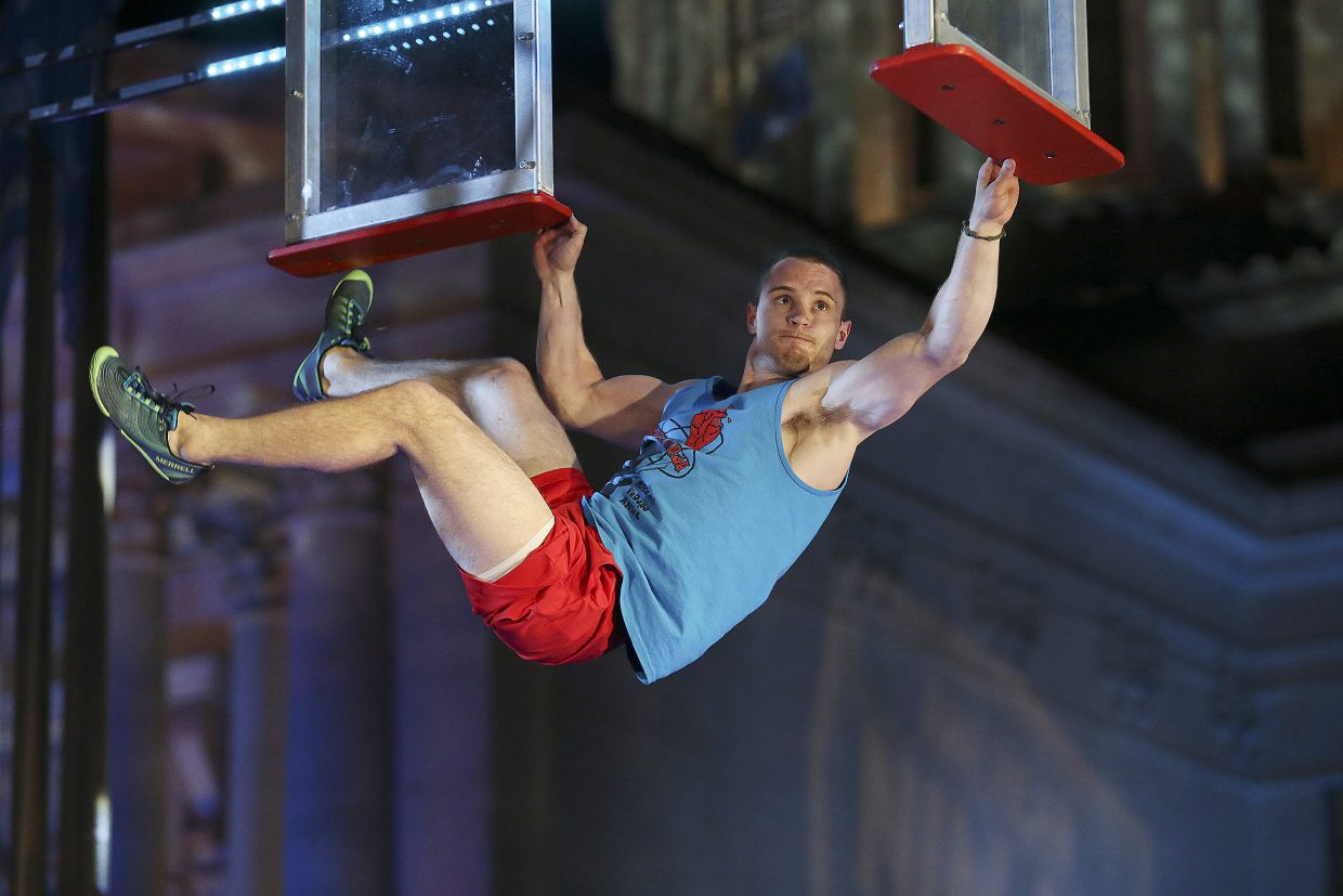 """Hayden High School graduate Mitchell VeDepo clings to """"the window hang"""" obstacle on the NBC game show American Ninja Warrior. VeDepo made it to the finals of the show's Oklahoma City regional, then did well enough there to advance to the Las Vegas finals."""