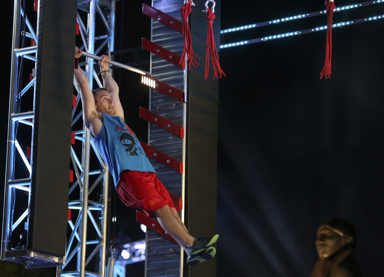 Mitchell VeDepo looks ahead from one tough obstacle to the next during the Oklahoma City finals of American Ninja Warrior. VeDepo successfully cleared both and advanced to the Las Vegas stage of the competition.