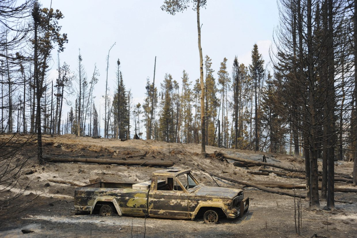A truck sits in a burned out section of the Beaver Creek fire.