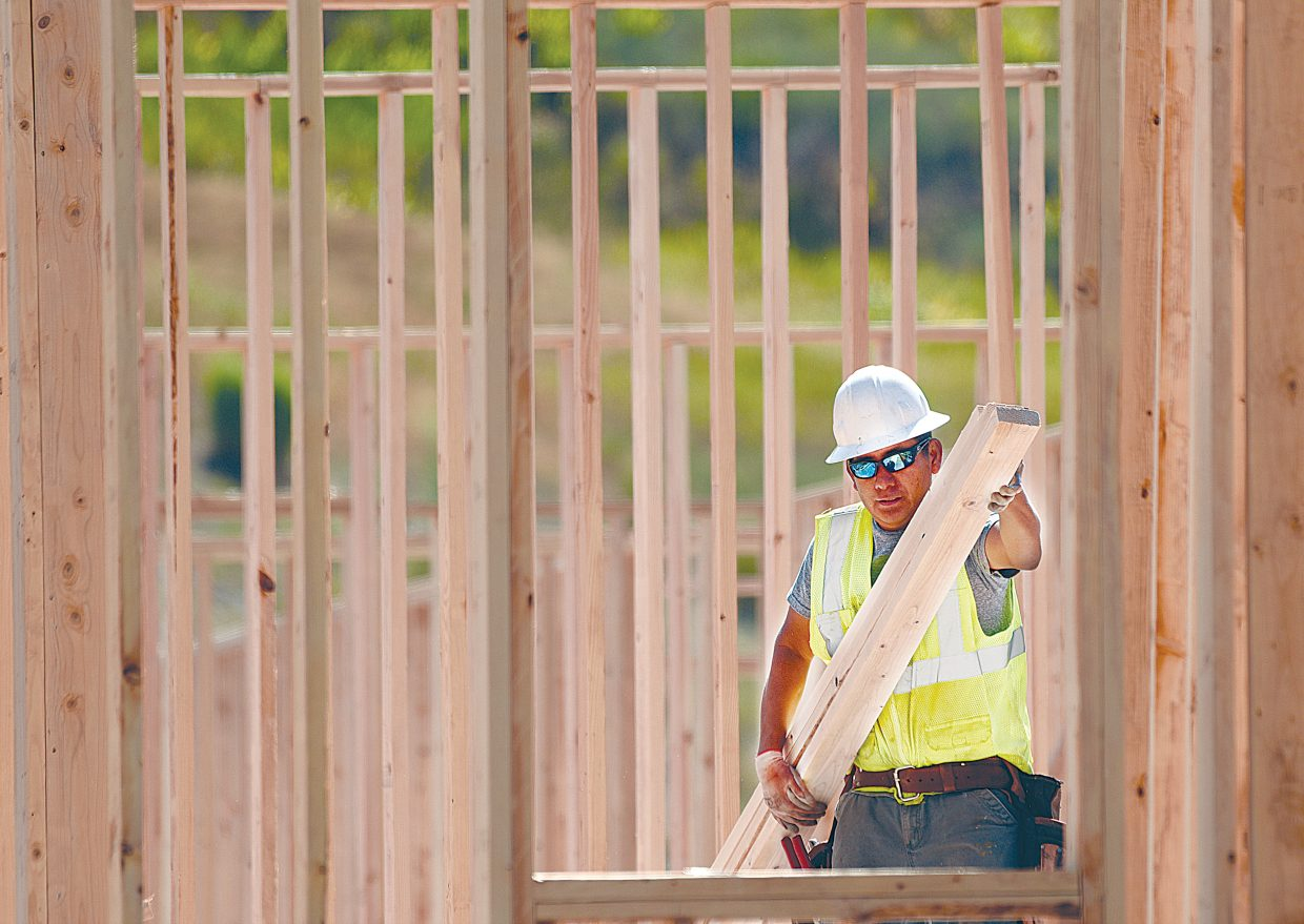 Framing foreman Jaime Perez works putting up the walls at The Reserves at Steamboat construction site on lower Elk River Road on Wednesday. When finished, the 48 income-restricted apartments will offer an affordable housing option on the westside of Steamboat Springs.