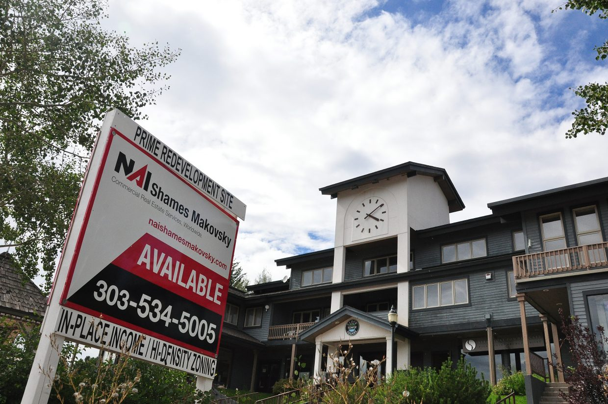 The Clock Tower Square building and surrounding property has been sold for $2.9 million to a developer who wants to redevelop the site with additional residential, commercial and retail spaces.