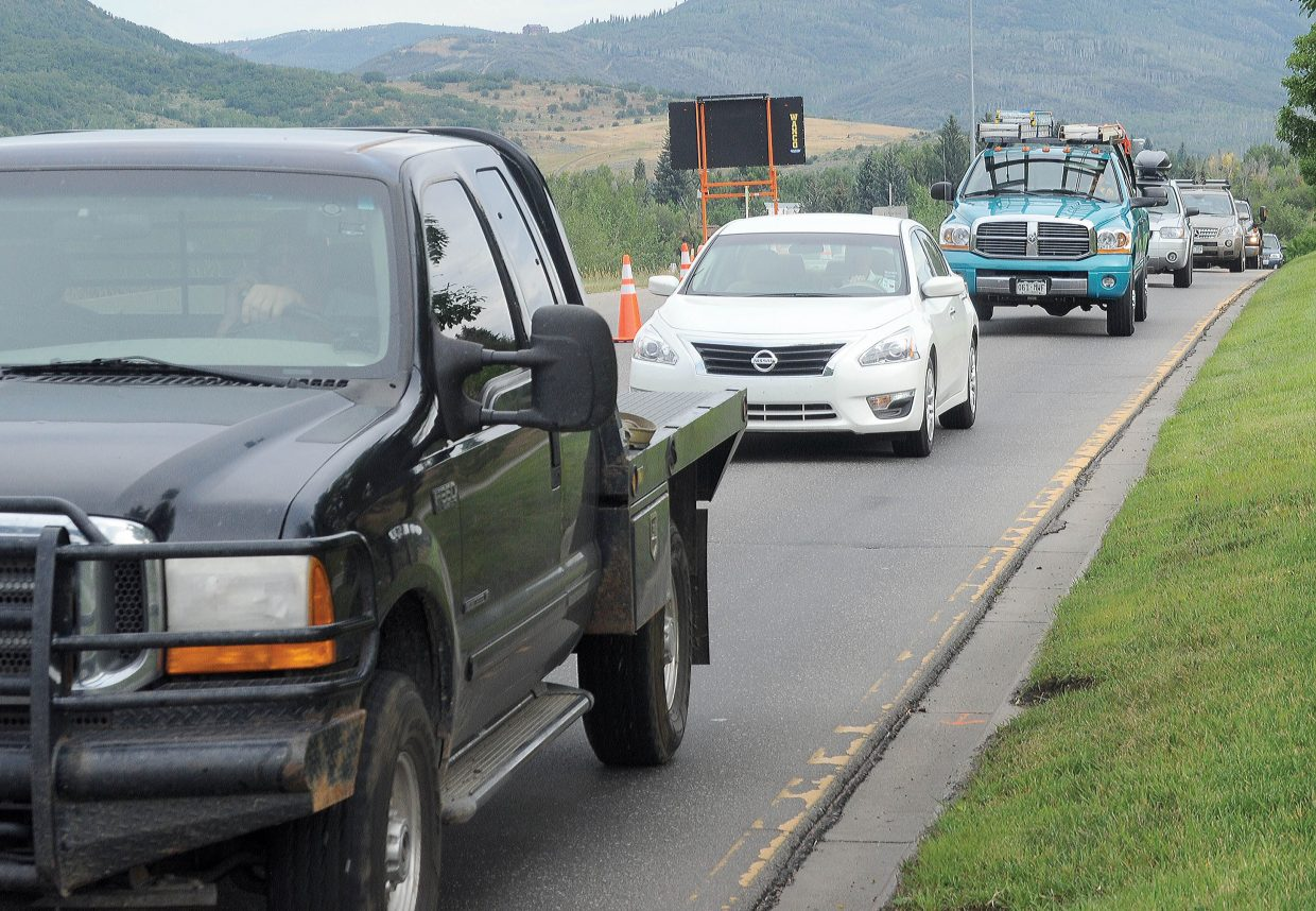 Road construction is officially underway in Steamboat Springs as witnessed by the traffic that was backed up along Lincoln Avenue traveling east out of downtown Steamboat Springs Monday morning. Commuters should expect more delays as a major repaving project takes place on U.S. Highway 40 in the Steamboat area. One-lane traffic should be expected near Pine Grove Road on the east end of town and near Elk River Road to the west.
