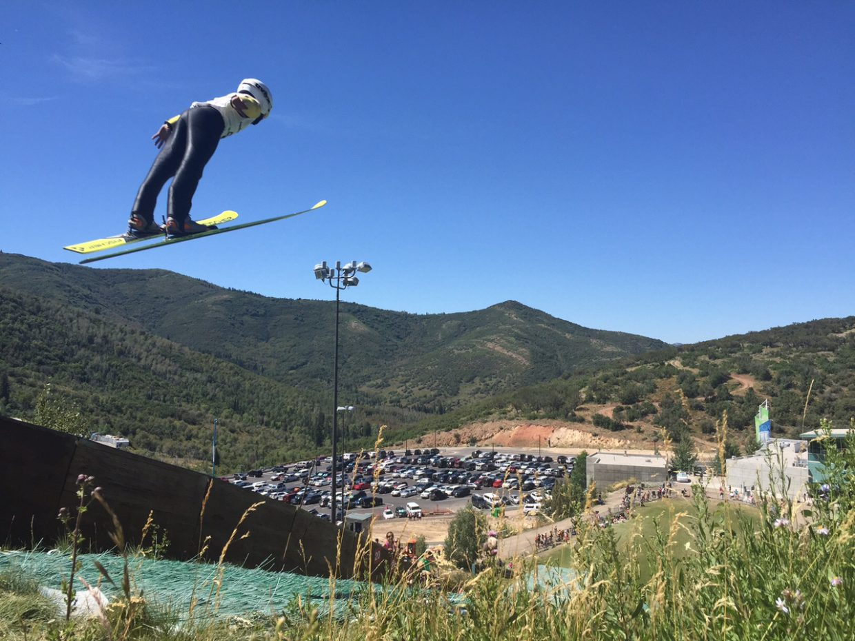 Gunnar Gilbertson flies off a ski jump in Park City last week during the Springer Tournee. The event drew 150 ski jumping and Nordic combined athletes for a week of camps and competition.