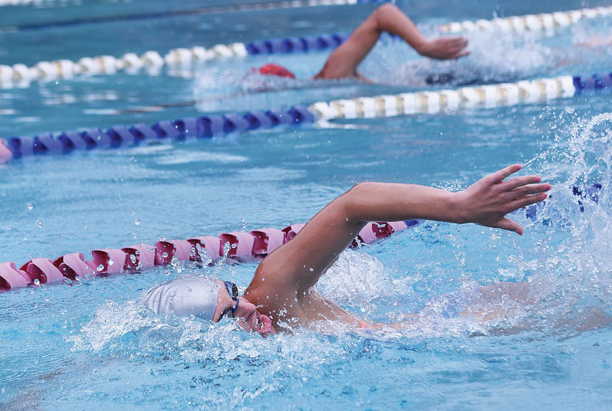 Swimmer Liz Roble races across the lap pool at the Old Town Hot Springs Thursday on her way to winning her race as part of a special Master's Swim Program swim meet.