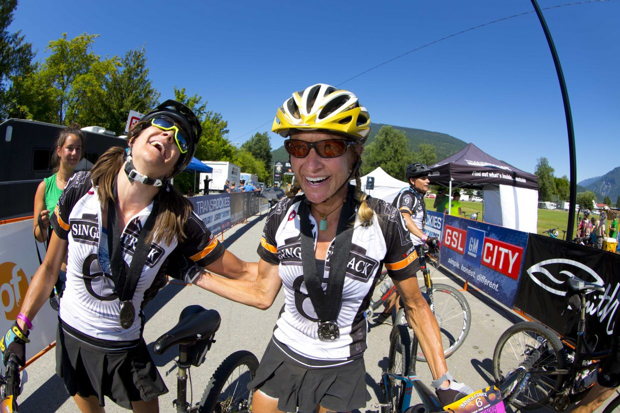 Mindy Mulliken, left, and Karen Tremaine celebrate after finishing the Singletrack 6 mountain bike race in Canada in first place. The pair dominated the women's open duo category through the event's six stages, winning by about 90 minutes.
