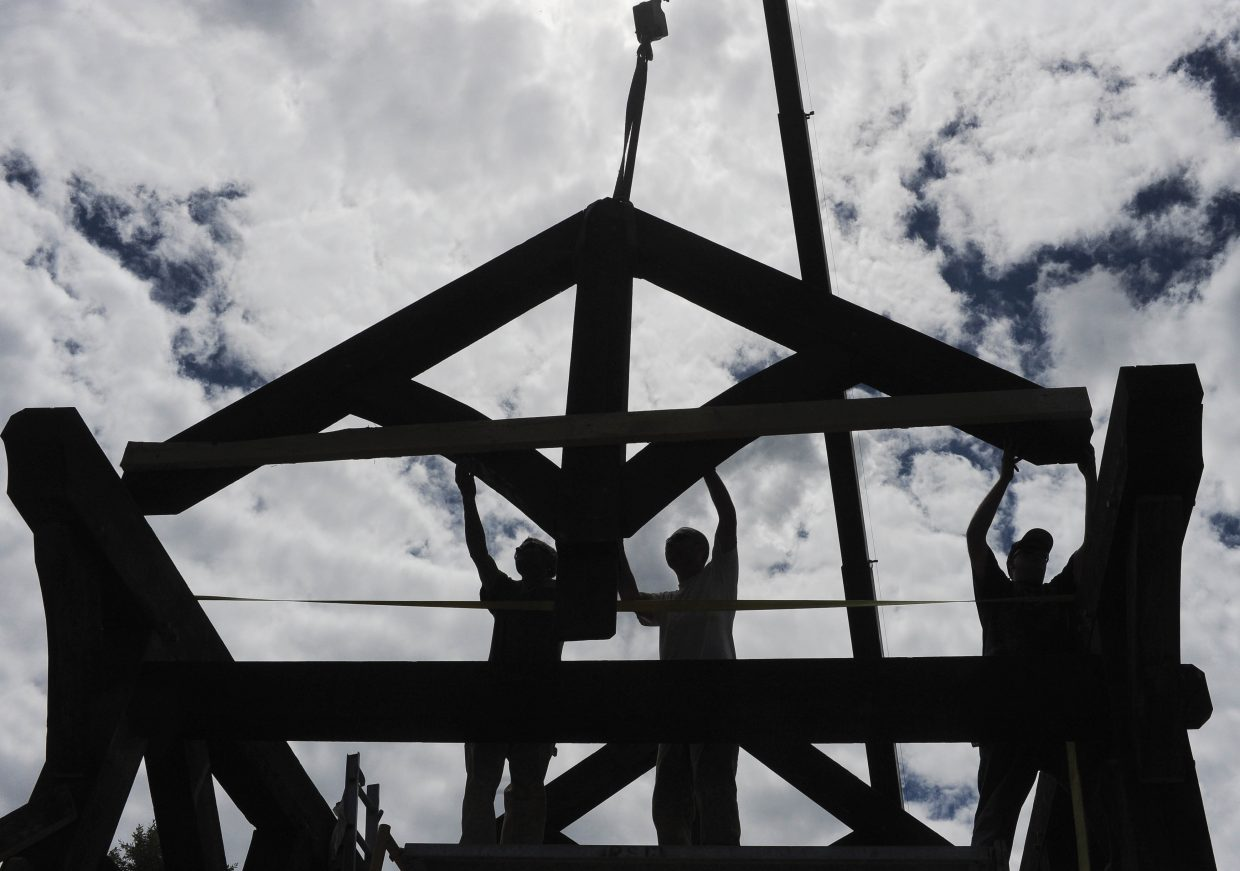 Larry Calistro, from left, Joe Redfern and Joe Bonn put a wooden truss in place at the new Peace Pavilion at Rotary River Park, which is currently being built near the entrance of Rotary Park just off the Yampa River Core Trail. Bonn, of J.Bonn Wood Products, crafted the structure at his sawmill and is setting it up on site using beetle-killed material a timber framing method.