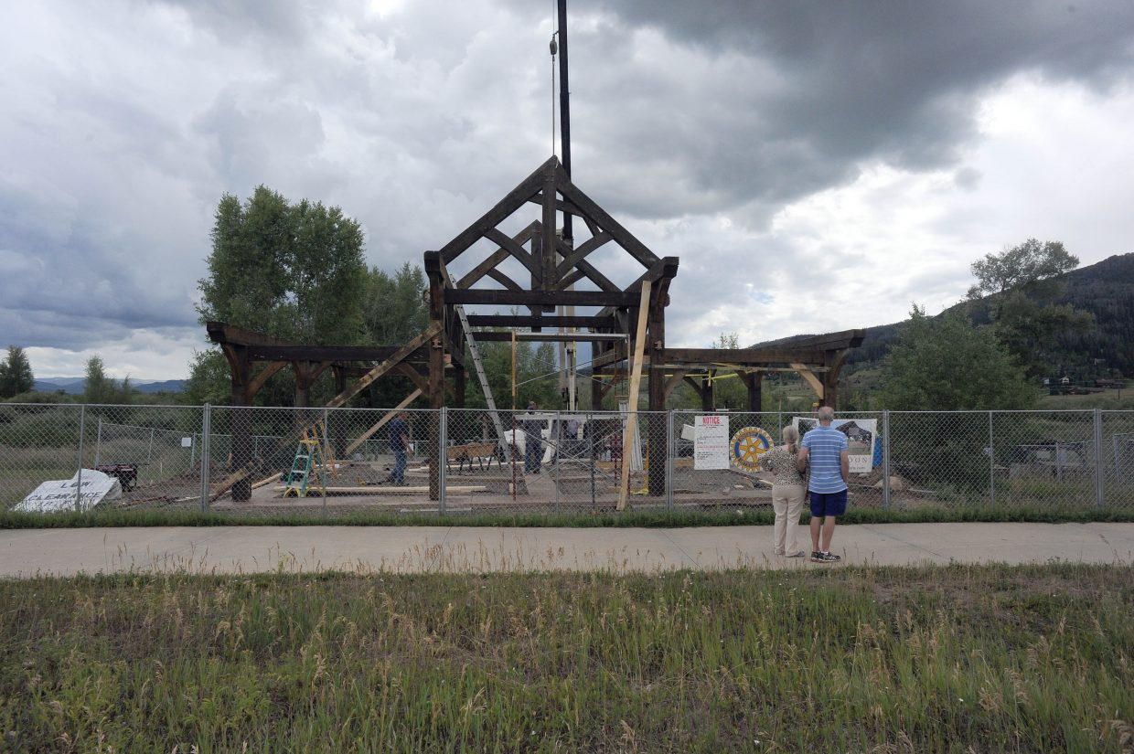 People stop while walking along the Yampa River Core Trail to check out the work on the Rotary Club's new Peace Pavilion at Rotary River Park. The club has raised about $75,000 for the project, which is expected to cost $140,000.