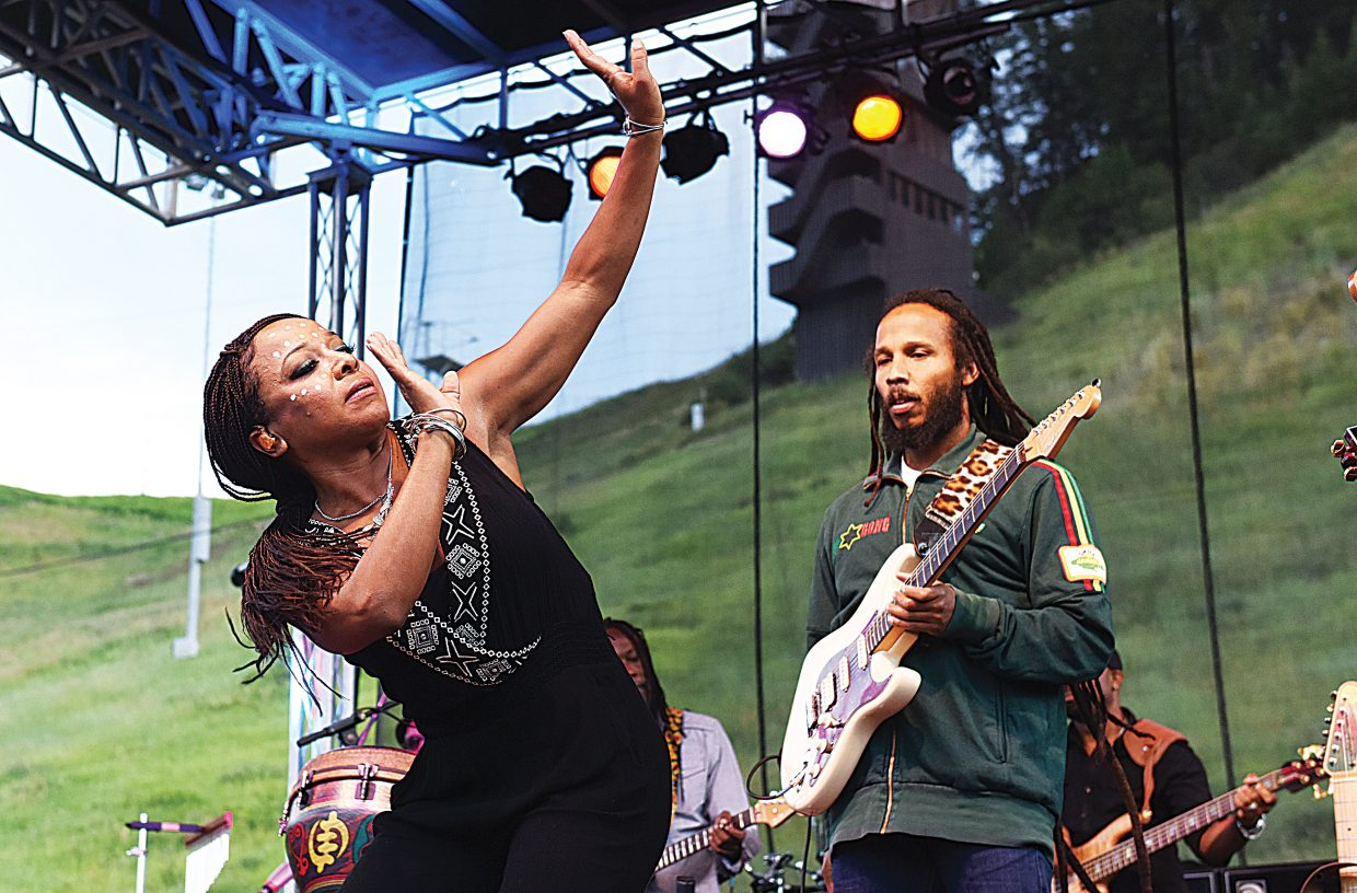 One of Ziggy Marley's dancers and backup singers performs on stage during one of the first numbers of Wednesday's free concert at Howelsen Hill. Thousands showed up for the event.